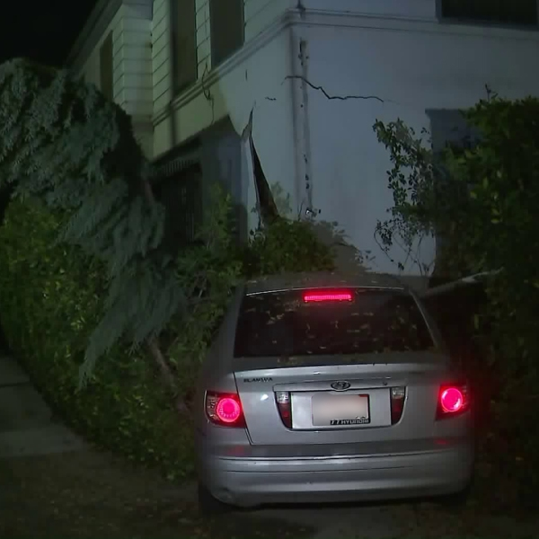 A car crashed into a building in Brentwood on Dec. 3, 2017. (Credit: KTLA)
