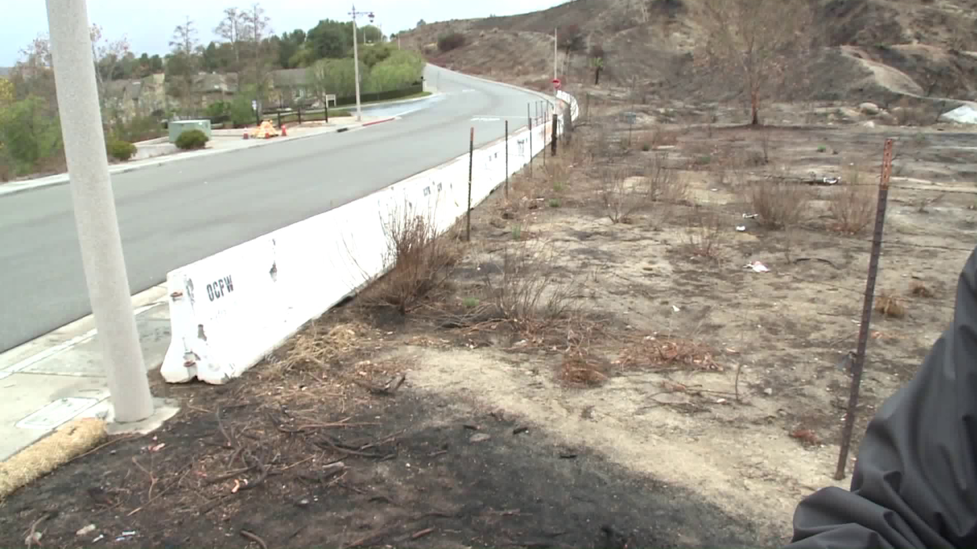A K-rail was erected in Anaheim Hills on Jan. 9, 2018, to stop mudslides from the Canyon Fire 2 burn area, but flowing debris did not materialize. (Credit: KTLA)