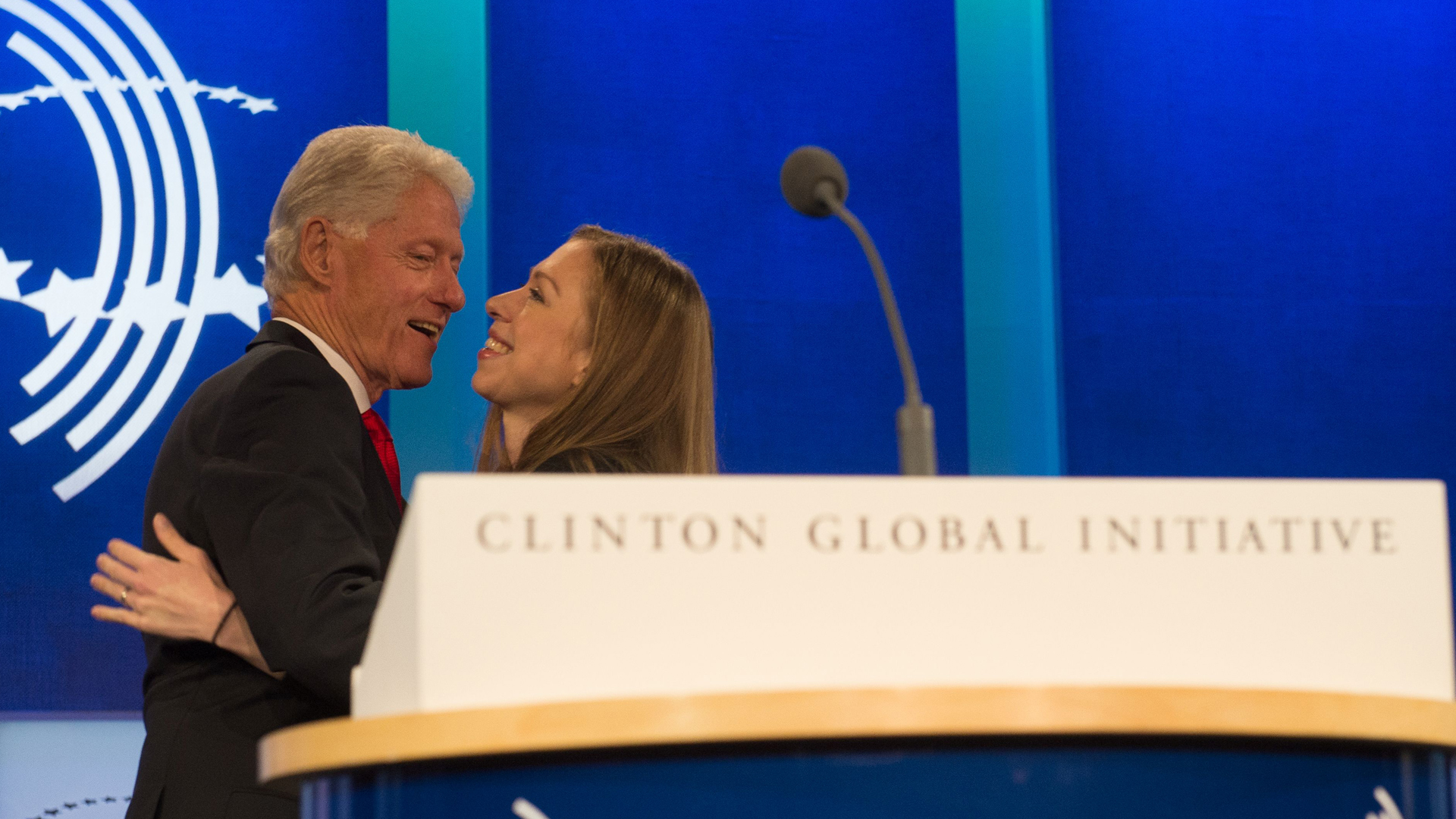 """Former President and Founding Chairman of the Clinton Global Initiative Bill Clinton, embraces Clinton Foundation Vice Chair and his daughter, Chelsea Clinton, at the closing Plenary Session: """"Imagine All The People"""" at the Clinton Global Initiative, on Sept., 21, 2016, in New York. (Credit: Bryan R. Smith /AFP/Getty Images)"""