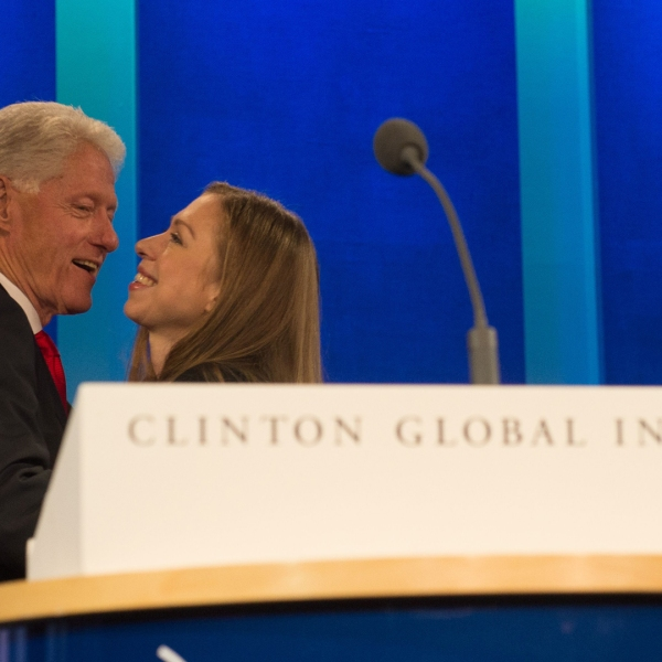 "Former President and Founding Chairman of the Clinton Global Initiative Bill Clinton, embraces Clinton Foundation Vice Chair and his daughter, Chelsea Clinton, at the closing Plenary Session: ""Imagine All The People"" at the Clinton Global Initiative, on Sept., 21, 2016, in New York. (Credit: Bryan R. Smith /AFP/Getty Images)"