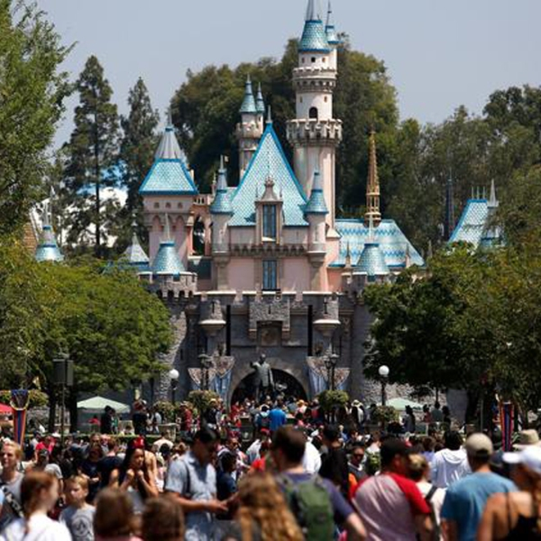 Crowds walk down Main Street in front of Sleeping Beauty Castle at Disneyland in Anaheim in June 2017. (Credit: Gary Coronado / Los Angeles Times)