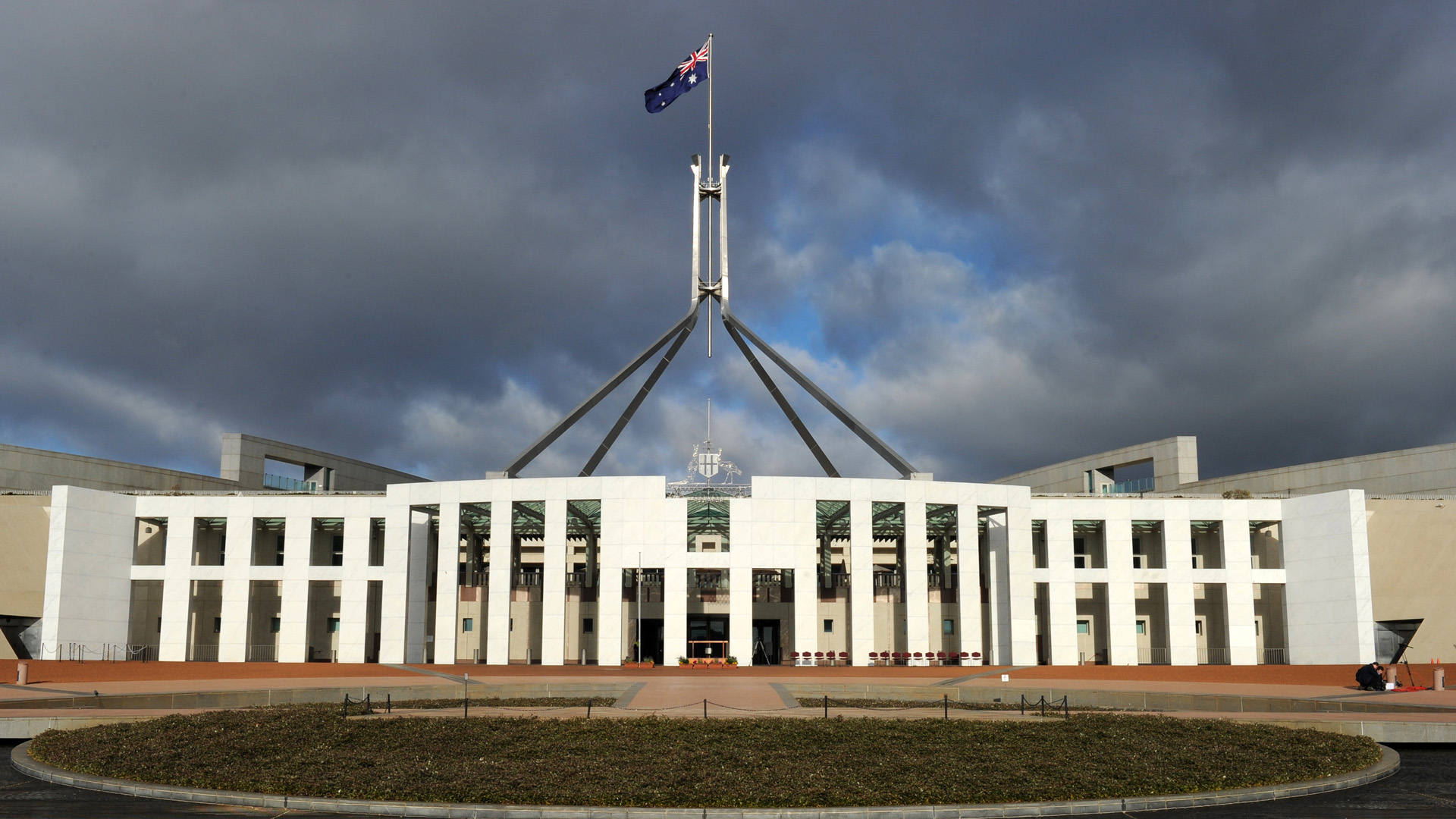The Australian national flag flies over Parliament House in Canberra on June 20, 2011. (Credit: TORSTEN BLACKWOOD/AFP/Getty Images)