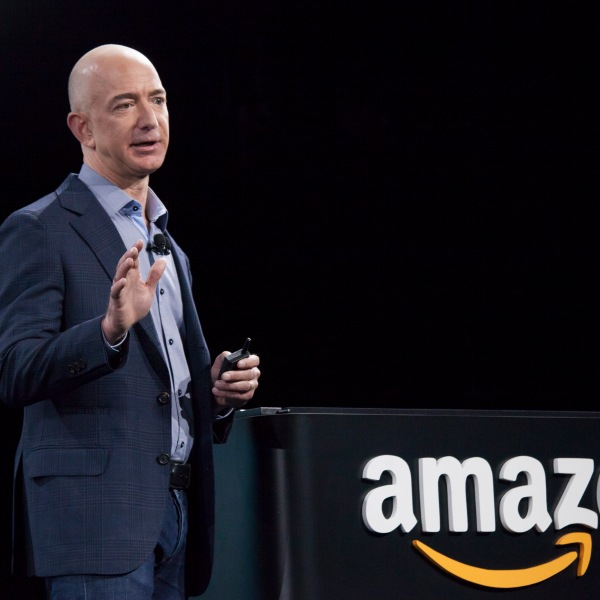 Amazon.com founder and CEO Jeff Bezos presents the company's first smartphone, the Fire Phone, on June 18, 2014 in Seattle, Washington. (Credit: David Ryder/Getty Images)