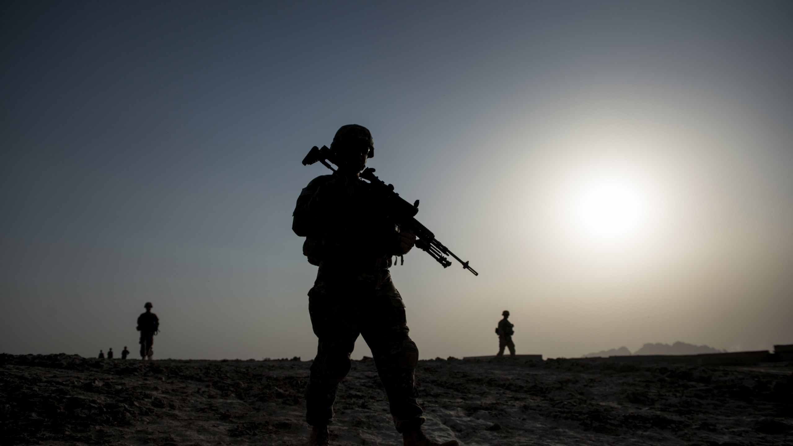 U.S. soldiers patrol near Kandahar Airfield on June 3, 2014. (Credit: BRENDAN SMIALOWSKI/AFP/Getty Images)