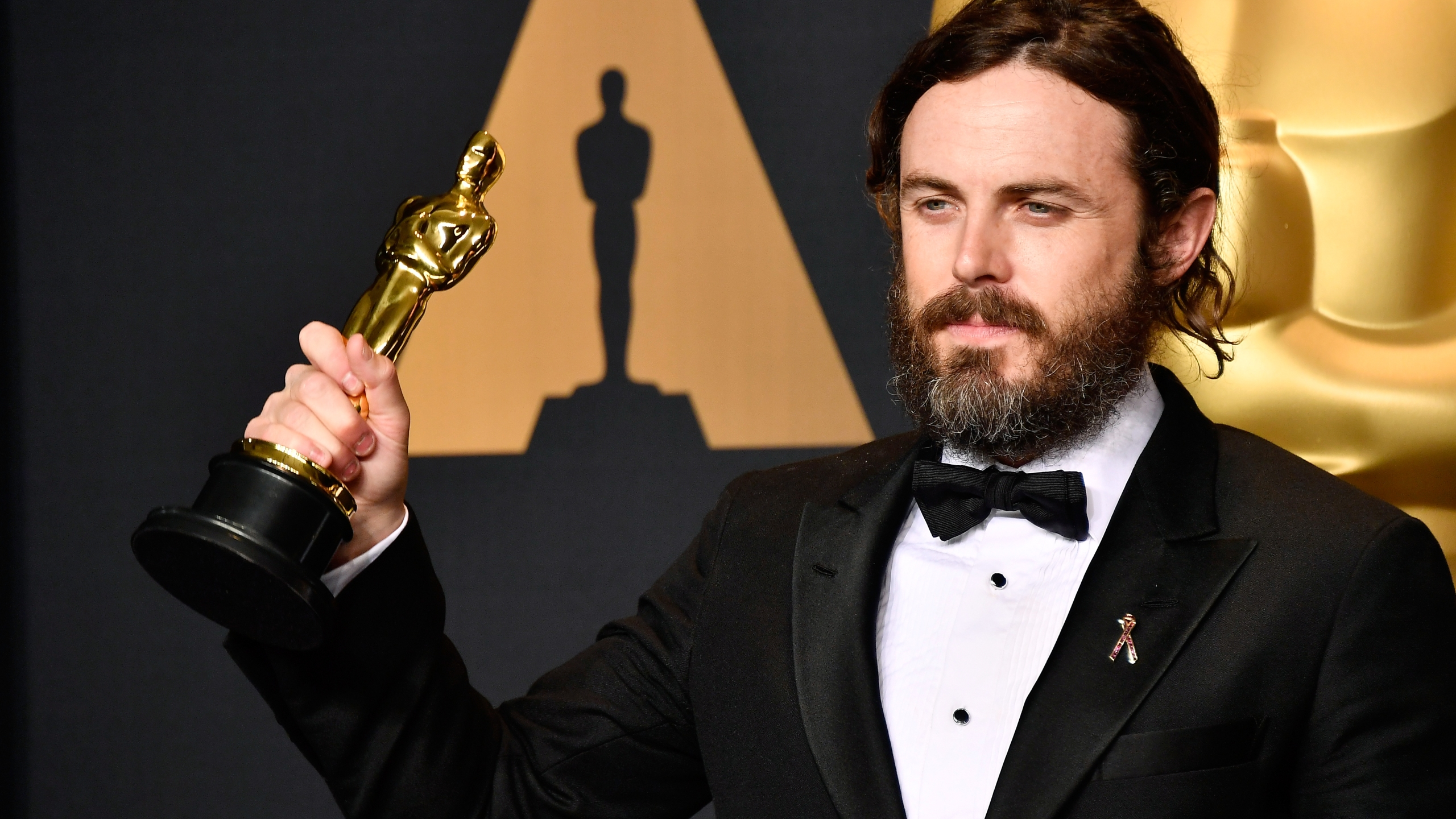 "Actor Casey Affleck, winner of Best Actor for ""Manchester by the Sea,"" poses in the press room during the 89th Annual Academy Awards at Hollywood & Highland Center on Feb. 26, 2017. (Credit: Frazer Harrison / Getty Images)"