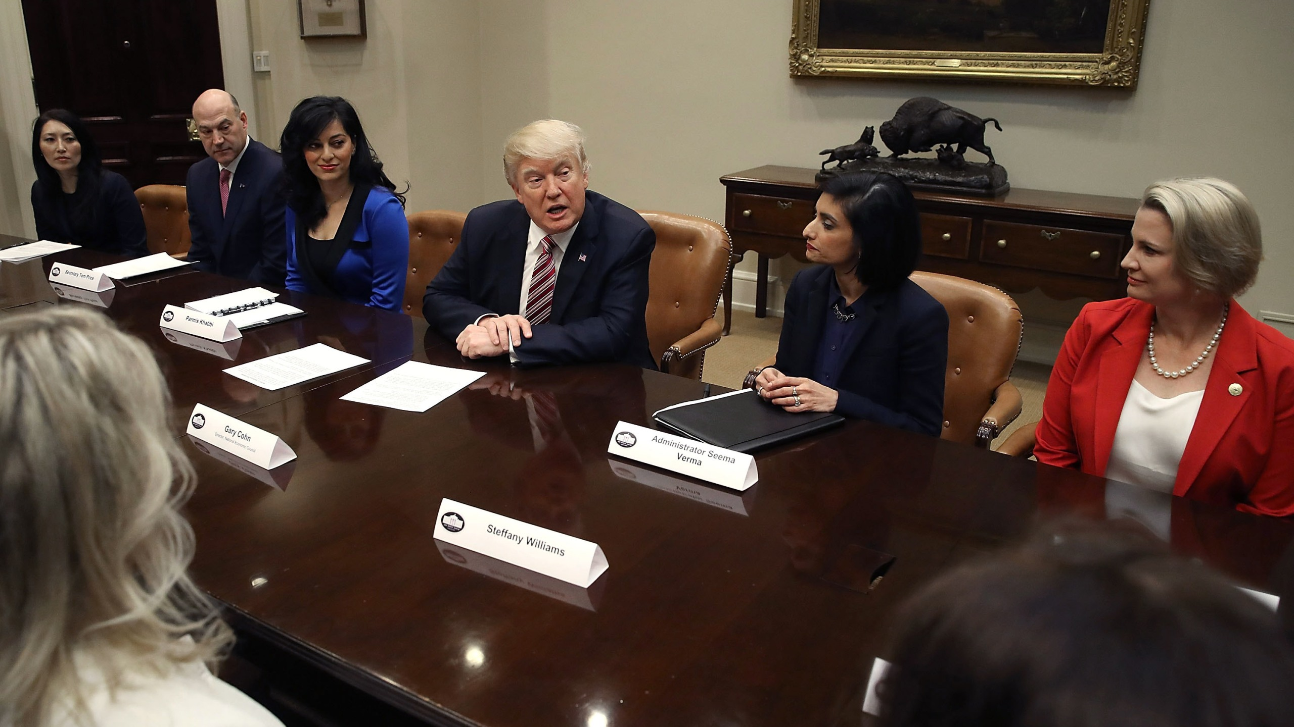 President Donald Trump speaks to participants of a women in healthcare panel hosted by Centers for Medicare and Medicaid Services head Seema Vermain, second from right, in the Roosevelt Room at the White House, March 22, 2017. (Credit: Mark Wilson / Getty Images)