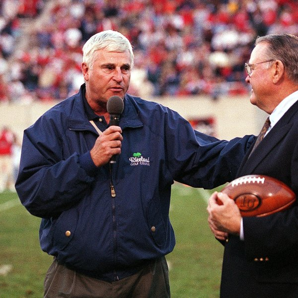 Sportscaster Keith Jackson, right, speaks to Indiana coach Bobby Knight during a game between the Ohio State Buckeyes and the Indiana Hoosiers at the Memorial Stadium in Bloomington, Indiana on Oct. 31, 1998. (Credit: Getty Images)