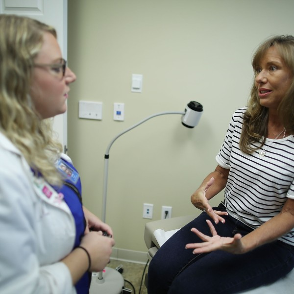 Ginger Rae speaks with registered nurse practitioner Rachel Eisenberg during a checkup at a Planned Parenthood health center on July 13, 2017, in Wellington, Florida. (Credit: Joe Raedle/Getty Images)