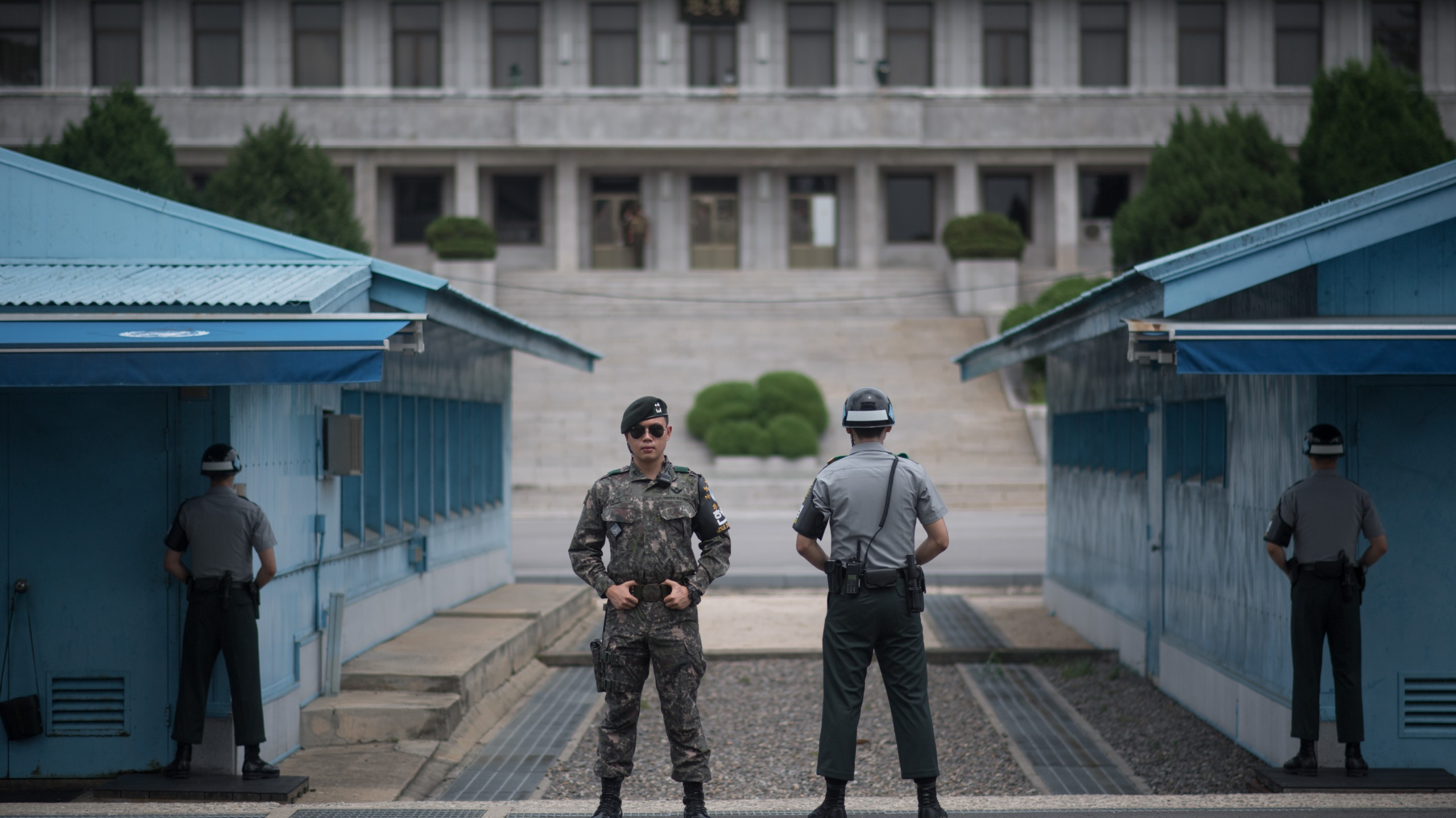 In a photo taken on Aug. 2, 2017, South Korean soldiers stand guard before North Korea's Panmon Hall and the military demarcation line separating North and South Korea, at Panmunjom, in the Joint Security Area of the Demilitarized Zone. (ED JONES/AFP/Getty Images)