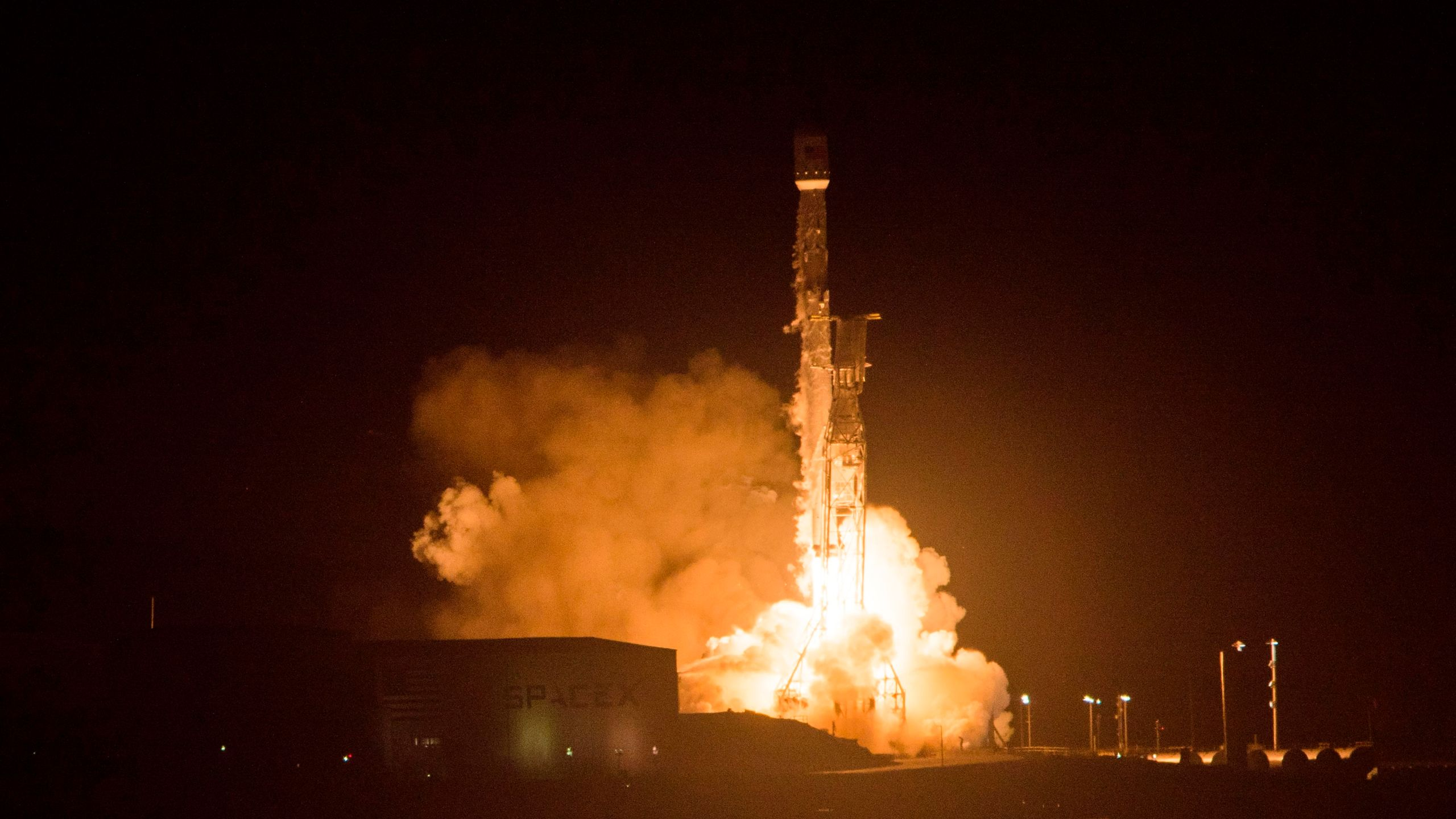 The SpaceX Falcon 9 rocket launches from Vandenberg Air Force Base in Lompoc on Dec. 22, 2017. (Credit: Robyn Beck / AFP / Getty Images)