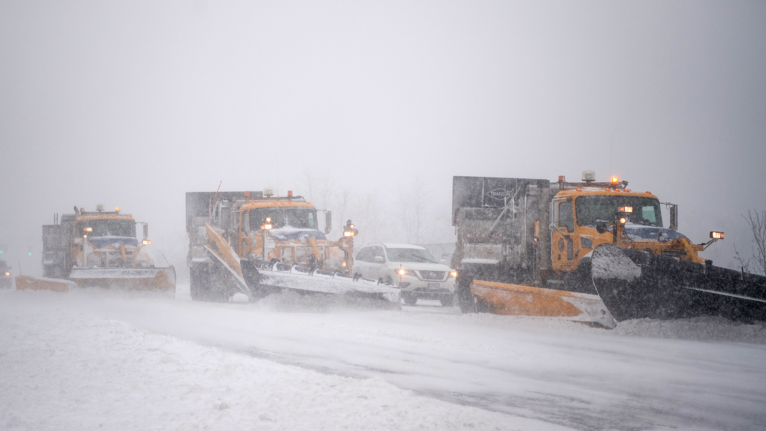 Trucks plow Rt. 112 as a blizzard hits the Northeastern part of the United States on Jan. 4, 2018 in Medford, New York. (Credit: Andrew Theodorakis/Getty Images)