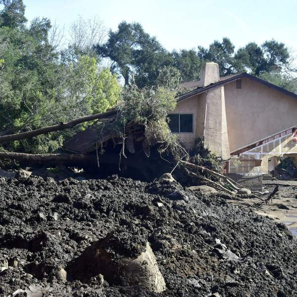 Rocks, mud and uprooted trees surround a demolished property in Montecito on Jan. 12, 2018. (Credit: FREDERIC J. BROWN/AFP/Getty Images)