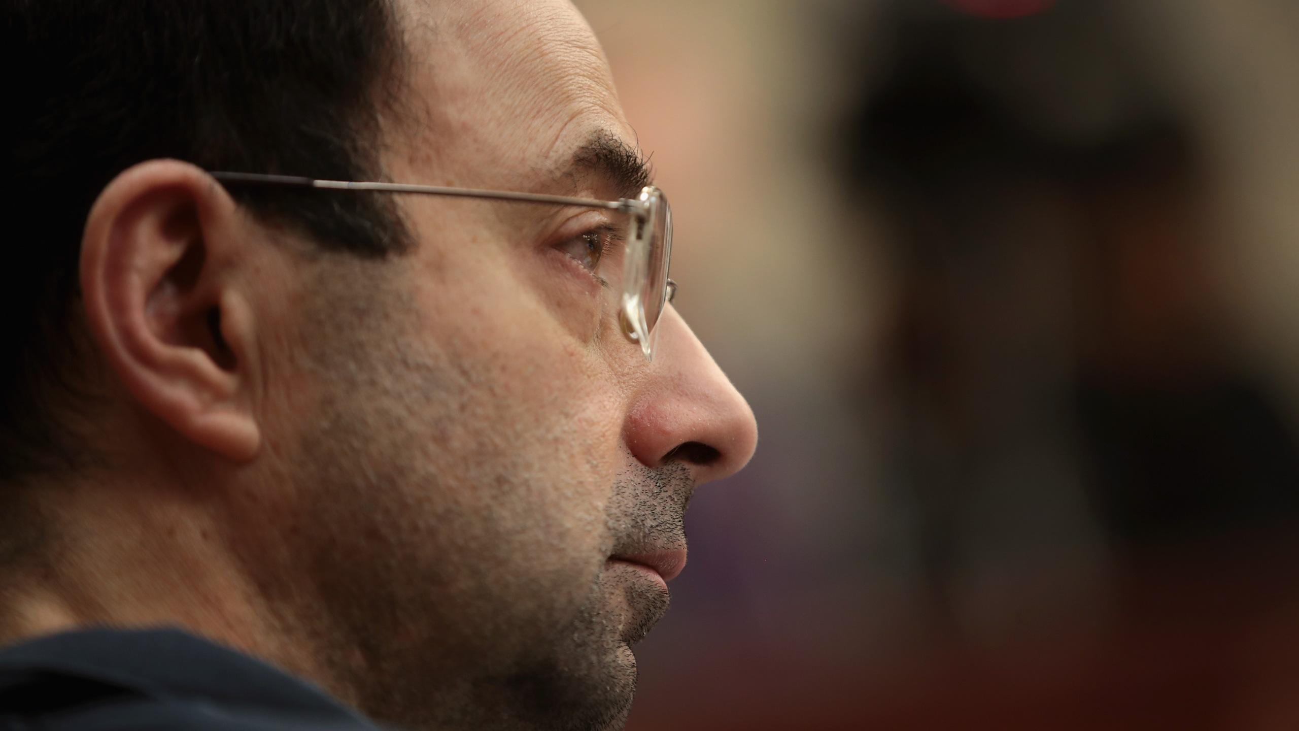 Larry Nassar listens to victim impact statements on January 17, 2018 during his sentencing hearing after being accused of molesting more than 100 girls while he was a physician for USA Gymnastics and Michigan State University. (Credit: Scott Olson/Getty Images)