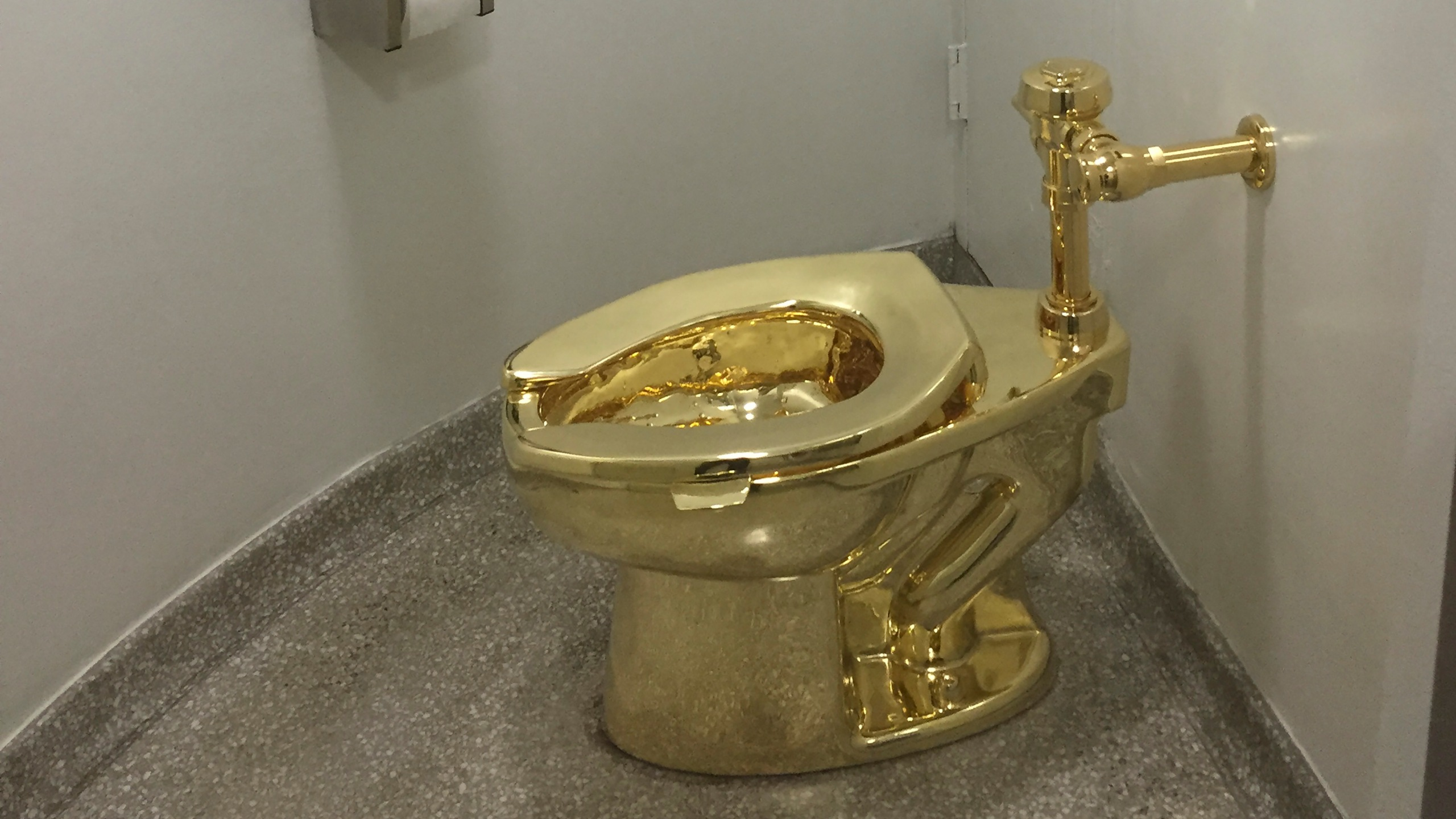 A fully functioning solid gold toilet, made by Italian artist Maurizio Cattelan, went into public use at the Guggenheim Museum in New York on Sept. 15, 2016. (Credit: William Edwards / AFP / Getty Images)