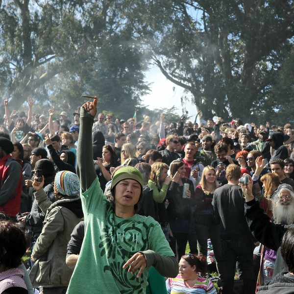 "A cloud of smoke rests over the heads of a group of people during a 420 Day celebration on ""Hippie Hill"" in Golden Gate Park April 20, 2010, in San Francisco. (Credit: Justin Sullivan/Getty Images)"