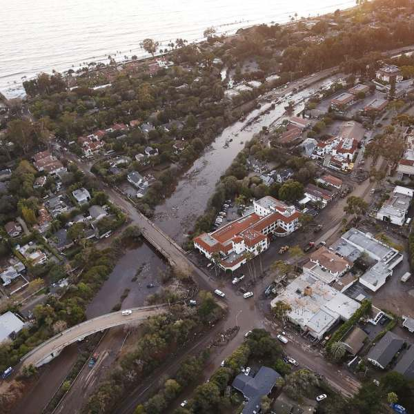 This undated photo shows mud, water and debris clog the 101 Freeway at the Olive Mill Road overpass in Montecito. (Credit: Al Seib / Los Angeles Times)