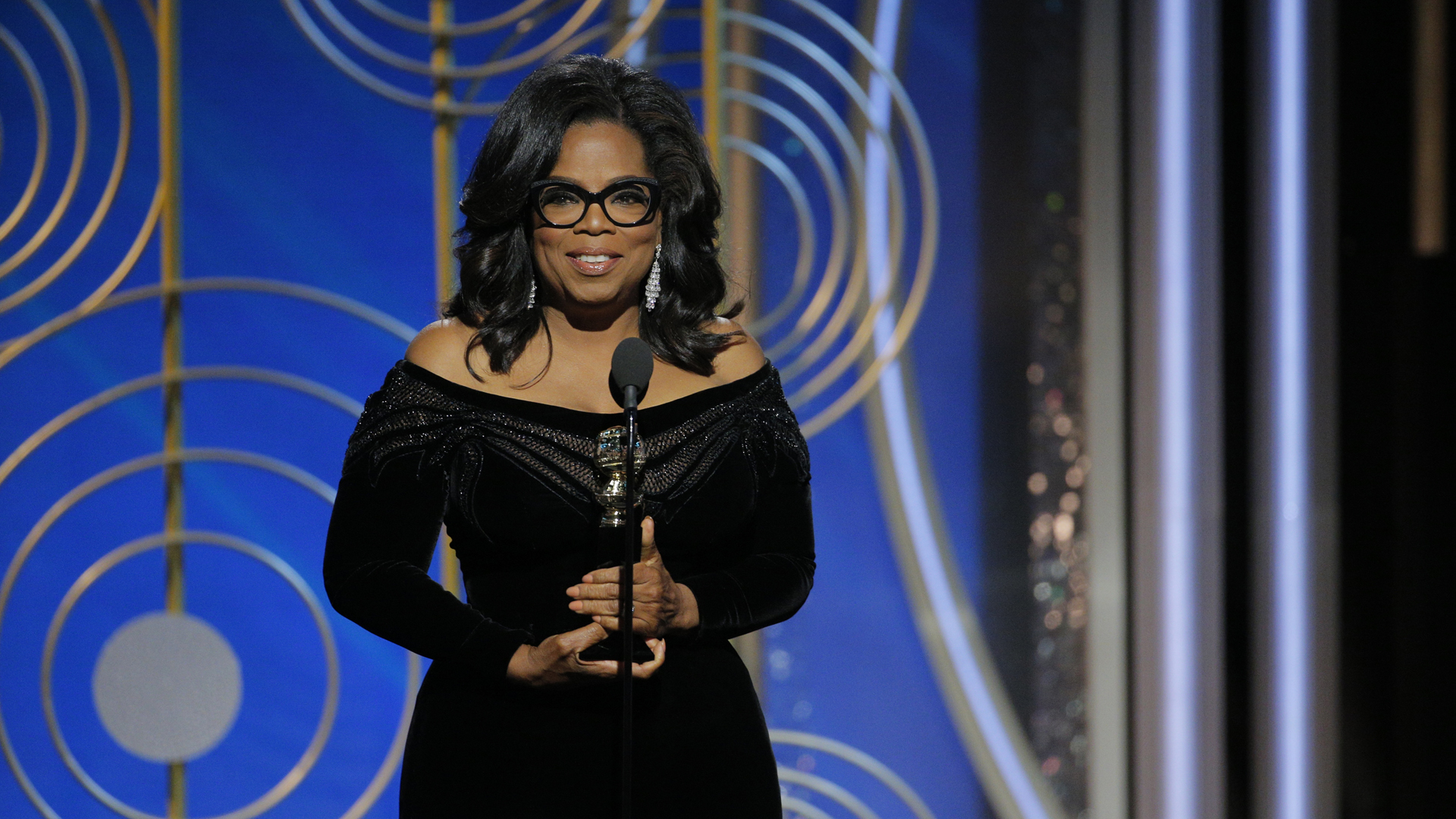 In this handout photo provided by NBCUniversal, Oprah Winfrey accepts the 2018 Cecil B. DeMille Award speaks onstage during the 75th Annual Golden Globe Awards at The Beverly Hilton Hotel on January 7, 2018s. (Credit: Paul Drinkwater/NBCUniversal via Getty Images)