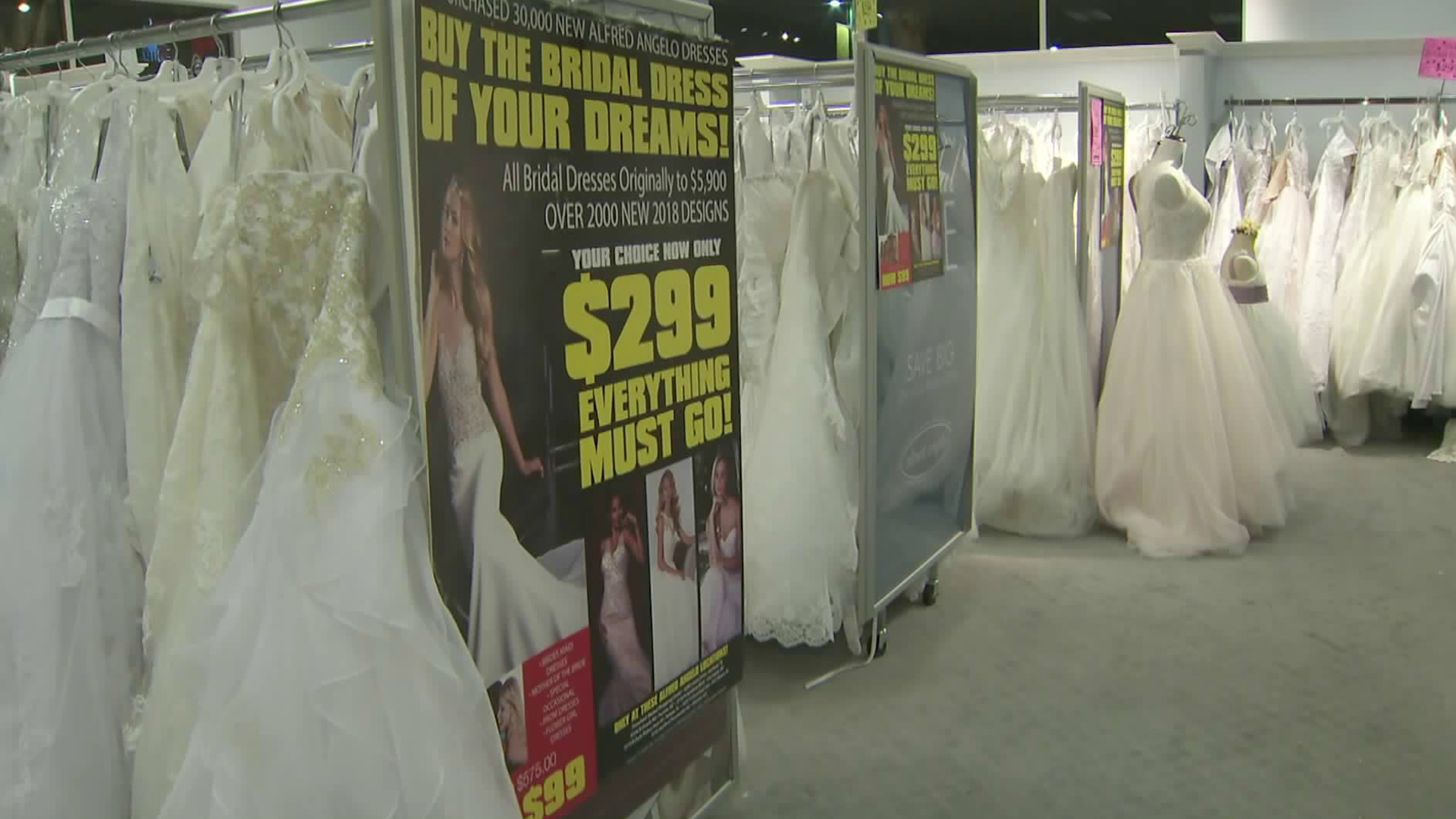 Wedding dresses are being sold at a steep discount -- just $299 each -- at the former Alfred Angelo Bridal store in West Covina. (Credit: KTLA)