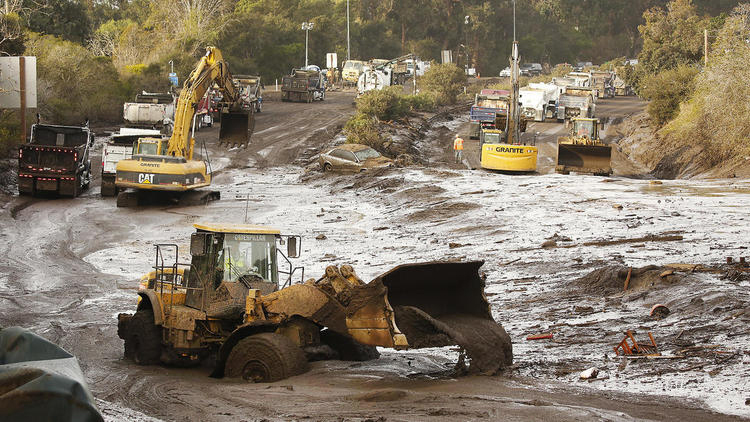 Crews continue to clear mud and debris from the 101 Freeway near Olive Mill Road. Officials said they hoped to have the freeway opened by next Monday. (Credit: Al Seib / Los Angeles Times)