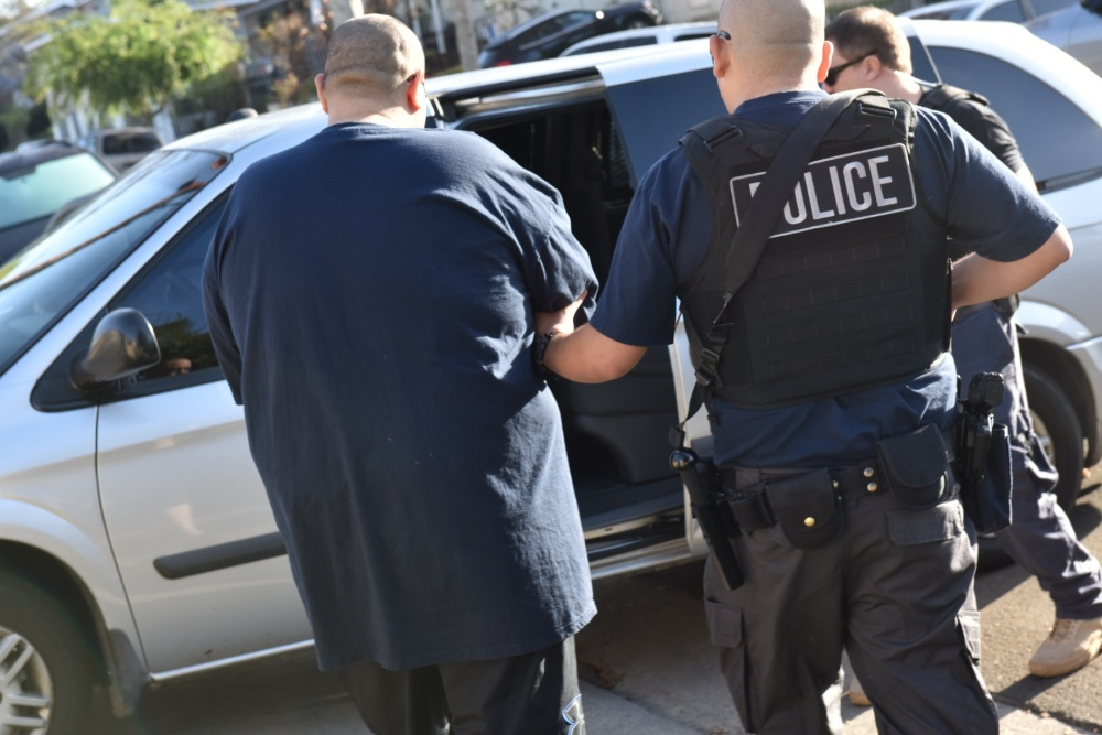 U.S. Immigration and Customs Enforcement agents make an arrest in Los Angeles in a photo released by the federal agency on Feb. 11, 2018.