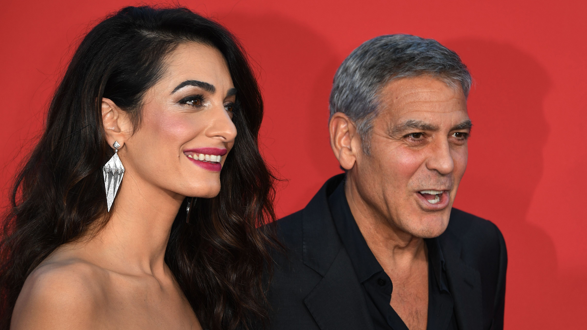 George Clooney and his wife Amal Clooney arrive for the Premiere of Paramount Pictures 'Suburbicon' at the Regency Village Theatre in Westwood, on October 22, 2017. (Credit: MARK RALSTON/AFP/Getty Images)