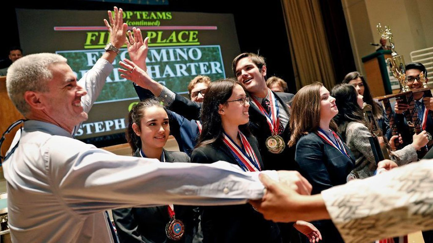 El Camino Real Charter High School students celebrate with principal David Hussey, left, after winning the 2018 L.A. Unified School District Academic Decathlon at Belmont High School on Feb. 11, 2018. (Credit: Christina House / Los Angeles Times)