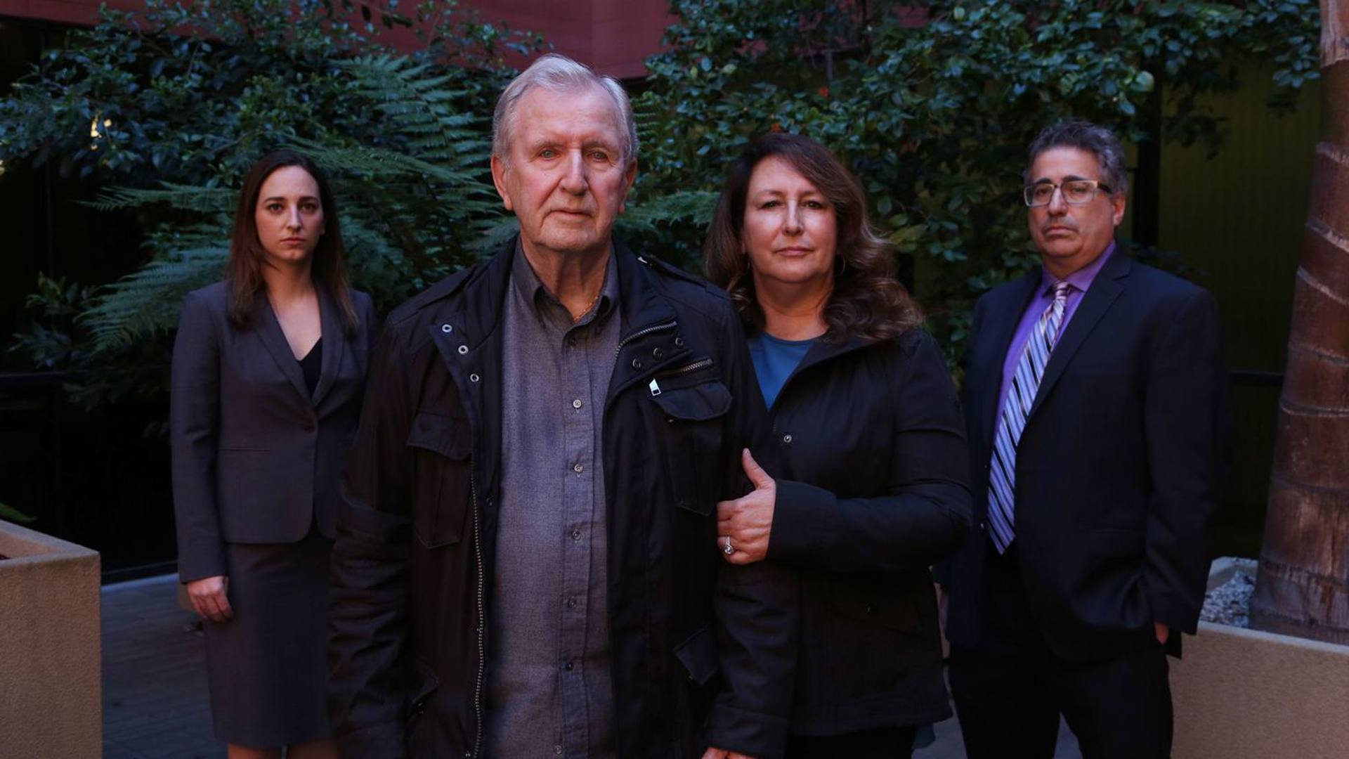 """Francis Kerrigan and Carole Meikle, center, and their lawyers Ryann E. Hall, left, and V. James DeSimone, contend the Orange County coroner switched one dead homeless man's body for another to cover up a botched death notification last May. """"It's a horror show on top of a horror show,"""" Kerrigan said. (Credit: Katie Falkenberg / Los Angeles Times)"""