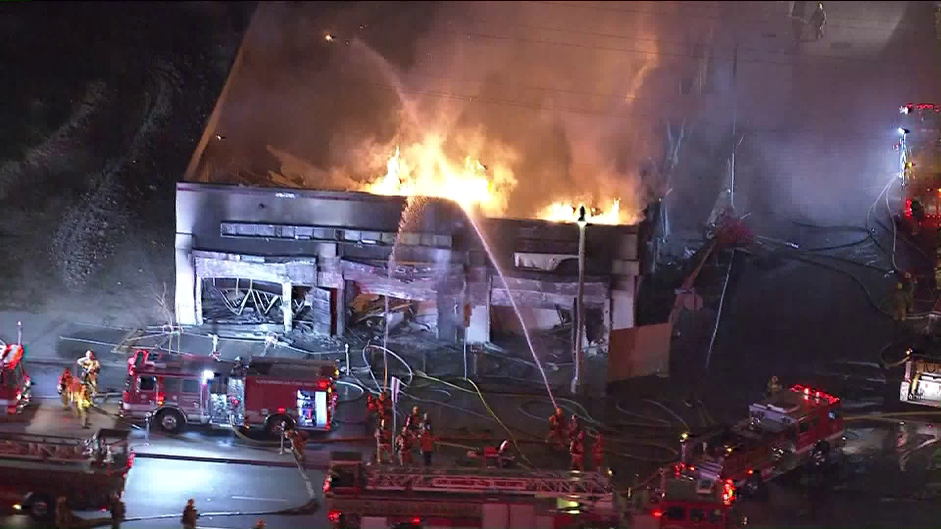 Firefighters are seen battling a blaze at a vacant strip mall in South L.A. on Feb. 13, 2018. (Credit: KTLA)