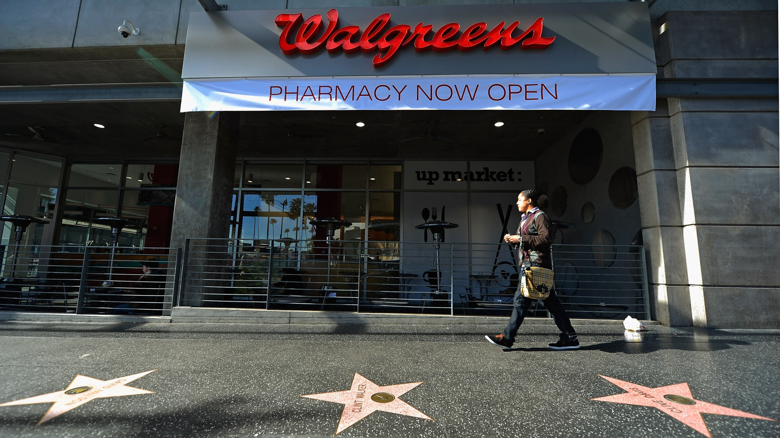 A woman walks past a Walgreens at the corner of Sunset and Vine in Hollywood on Jan. 15, 2013. (Credit: Kevork Djansezian / Getty Images)
