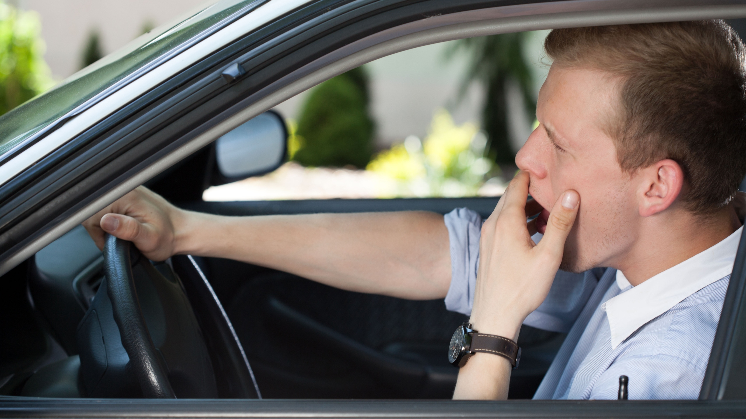 A drowsy driver is seen in this file photo. (Credit: iStock / Getty Images Plus)