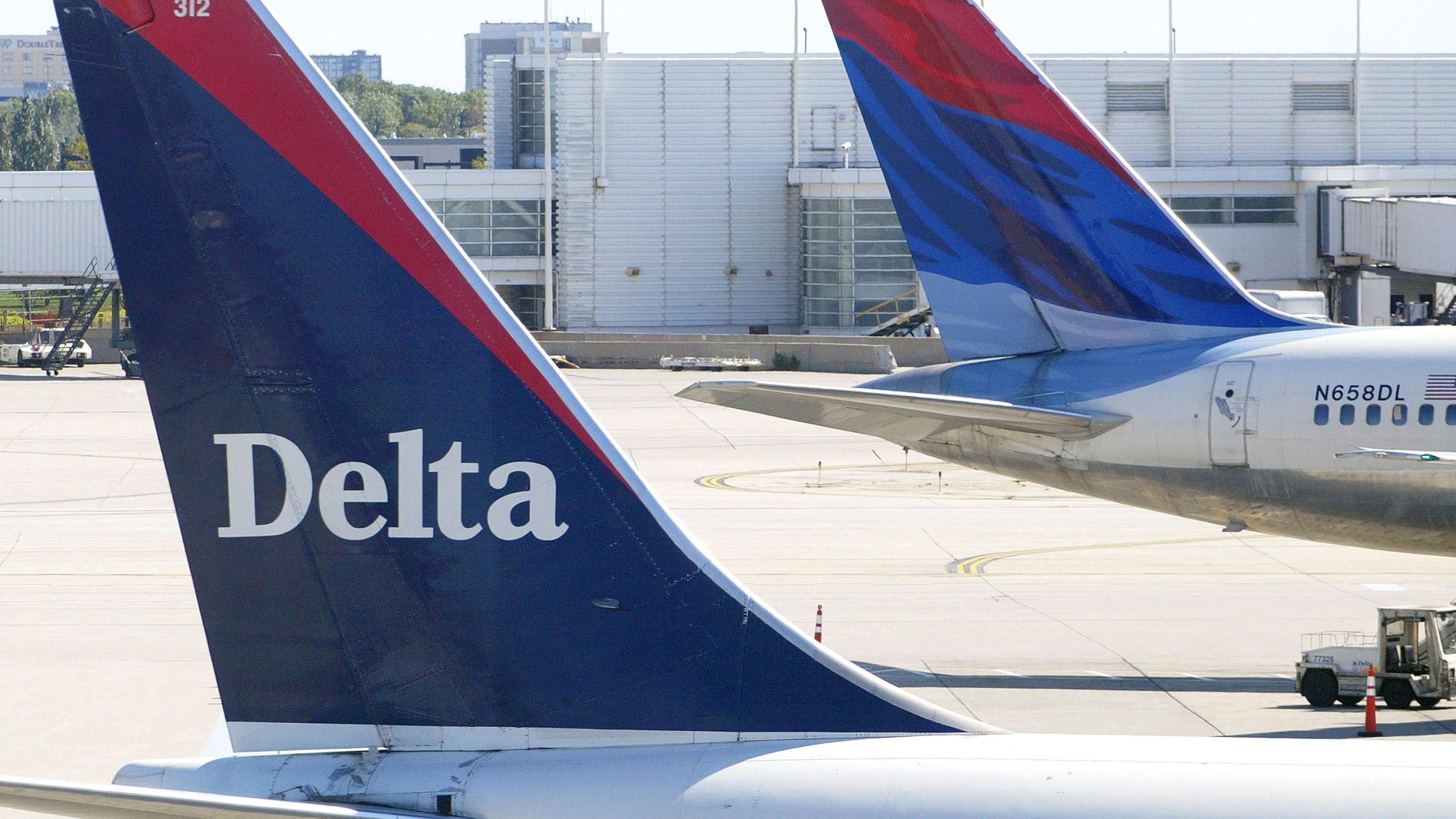 Tails of two Delta Air Lines jets are seen on Sept. 17, 2004 at O'Hare International Airport in Chicago, Illinois. (Credit: Tim Boyle/Getty Images)