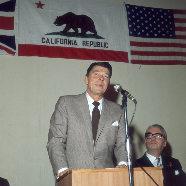 Governor of California and future President of the U.S. Ronald Reagan is seen speaking at a lunch in London in 1969. (Credit: Mike Lawn/Fox Photos/Getty Images)