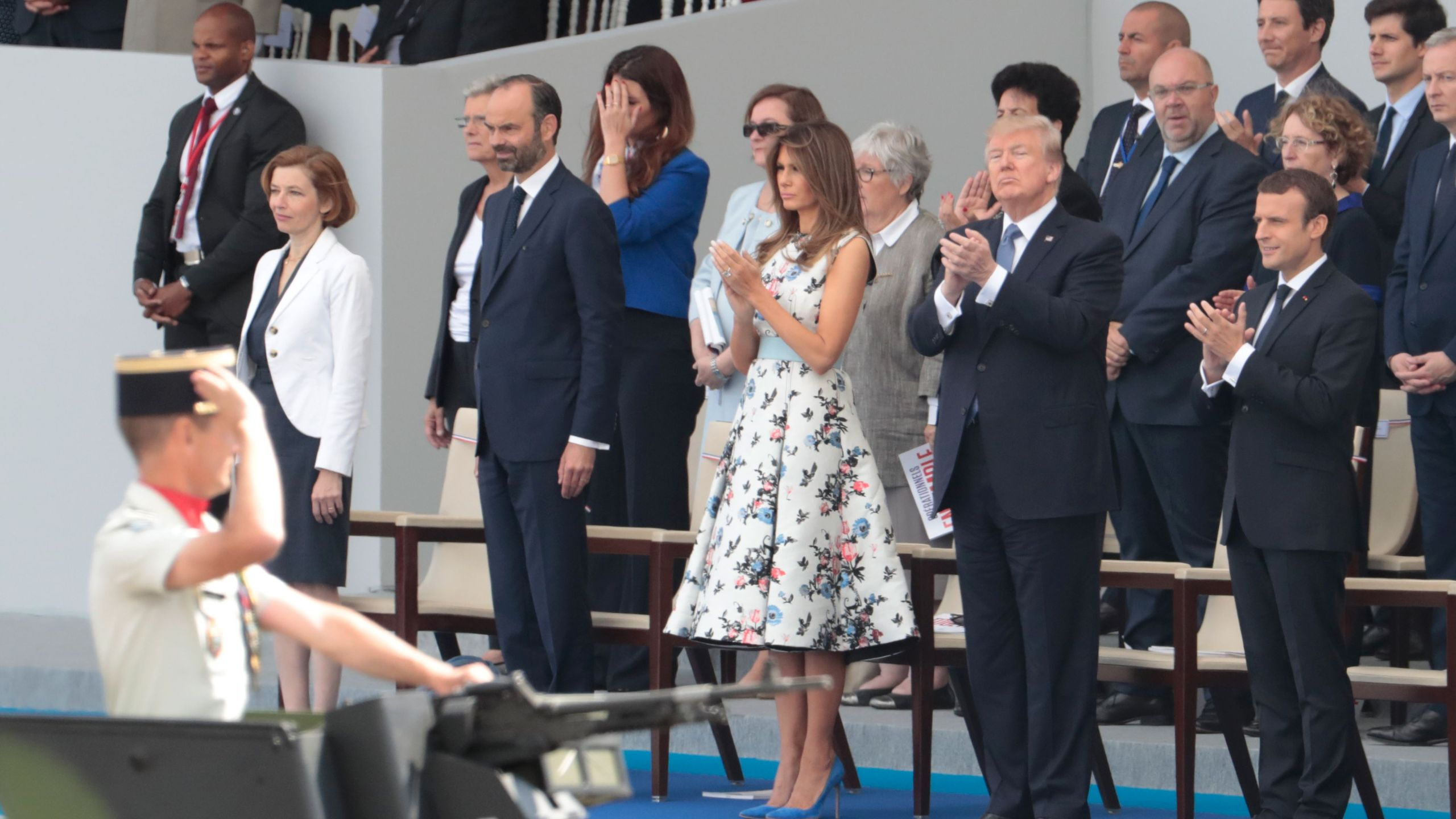 From right: French President Emmanuel Macron, President Donald Trump, First lady Melania Trump, French Prime Minister Edouard Philippe and French Defense Minister Florence Parly attend the annual Bastille Day military parade on the Champs-Elysees avenue in Paris, July 14, 2017. (Credit: Joel Saget / AFP / Getty Images)