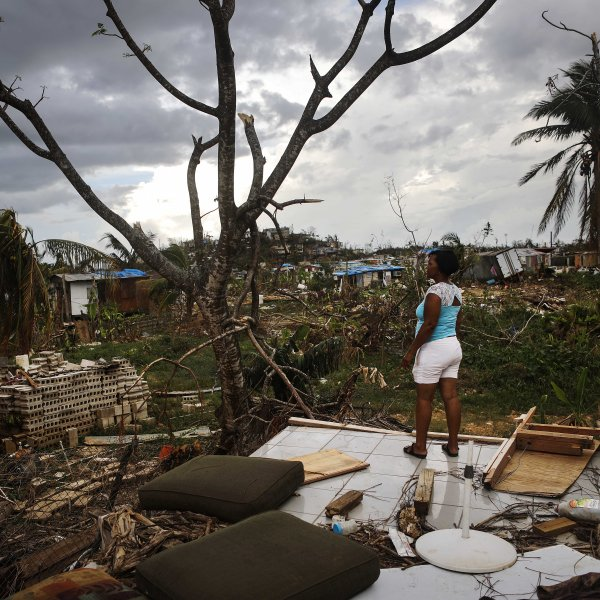 Resident Mirian Medina stands on her property about two weeks after Hurricane Maria swept through the island on Oct. 5, 2017 in San Isidro, Puerto Rico. (Credit: Mario Tama/Getty Images)