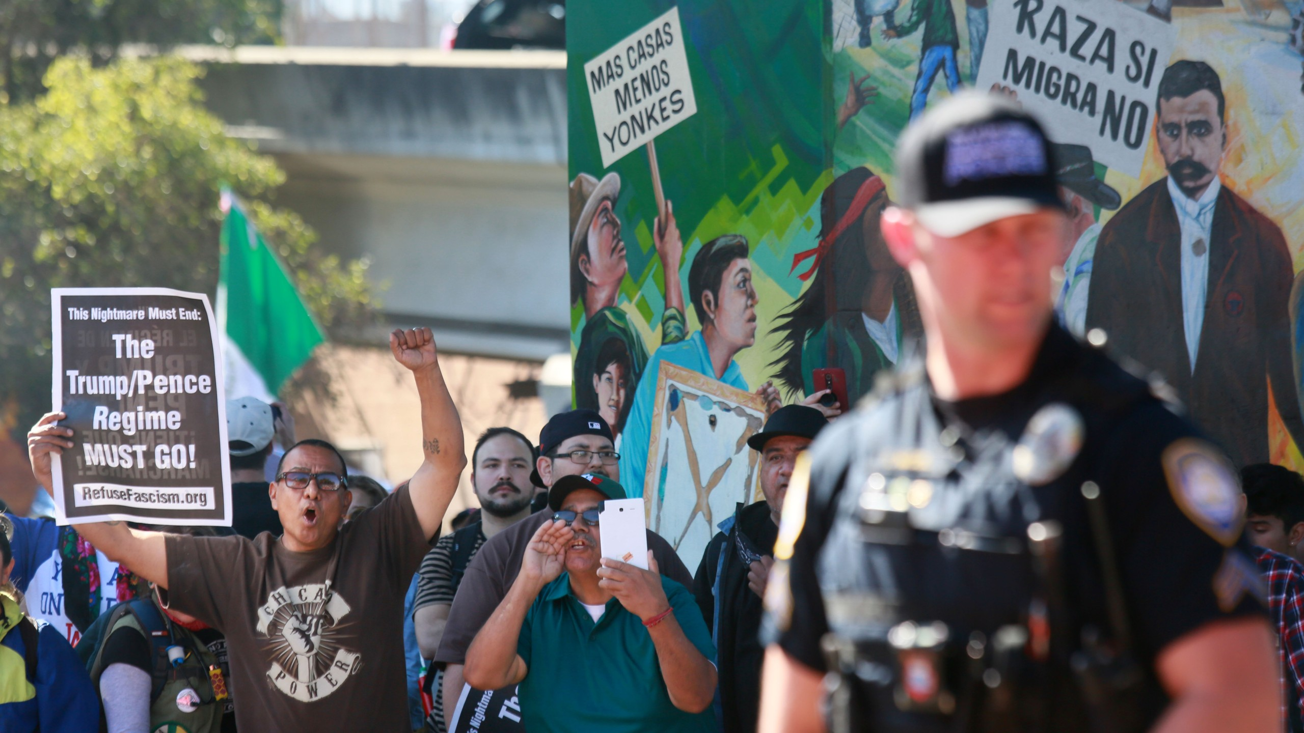 """Counter-demonstators chant during a """"Patriot Picnic"""" demonstration at Chicano Park in San Diego on Feb. 3, 2018. (Credit: Sandy Huffaker / AFP / Getty Images)"""