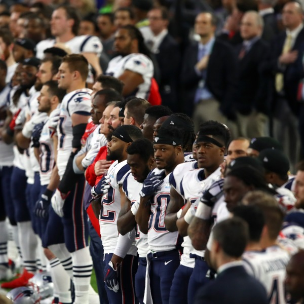 The New England Patriots stand during the National Anthem prior to Super Bowl LII against the Philadelphia Eagles at U.S. Bank Stadium on Feb. 4, 2018, in Minneapolis. (Credit: Gregory Shamus/Getty Images)