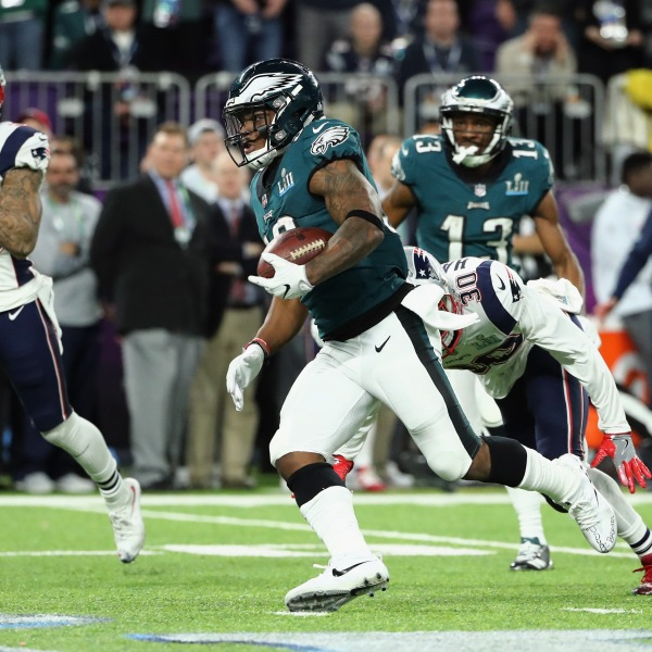 Corey Clement #30 of the Philadelphia Eagles carries the ball defended by Patrick Chung #23 and Duron Harmon #30 of the New England Patriots in the first half of Super Bowl LII at U.S. Bank Stadium on Feb. 4, 2018, in Minneapolis. (Credit: Elsa/Getty Images)