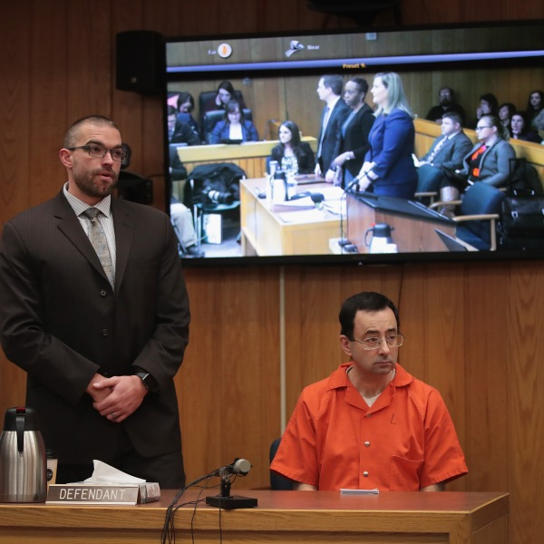 Larry Nassar sits with his attorney Matt Newburg as he is sentenced by Judge Janice Cunningham for three counts of criminal sexual assault in Eaton County Circuit Court on Feb. 5, 2018, in Charlotte, Mich. (Credit: Scott Olson/Getty Images)