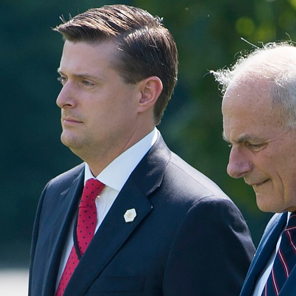 John Kelly, right, and Rob Porter walk to Marine One prior to departure from the South Lawn of the White House in Washington, D.C. on Aug. 4, 2017. (Credit: SAUL LOEB/AFP/Getty Images)