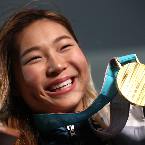 Gold medalist Chloe Kim of the United States poses during the medal ceremony for the snowboard ladies' halfpipe final in the PyeongChang 2018 Winter Olympic Games on Feb. 13, 2018. (Credit: Alexander Hassenstein / Getty Images)