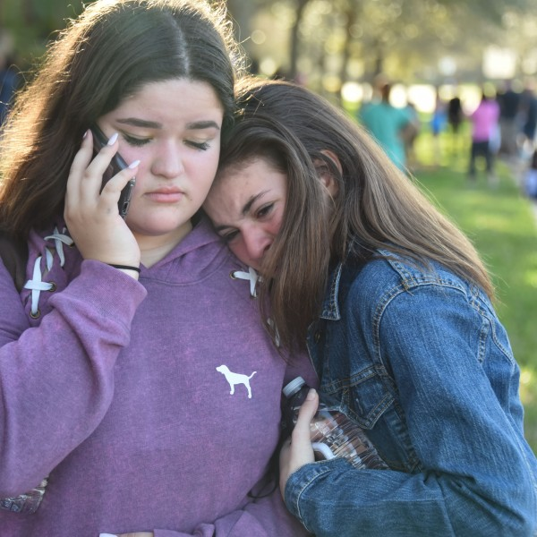 Students react following a shooting at Marjory Stoneman Douglas High School in Parkland, Florida, on Feb. 14, 2018. (Credit: MICHELE EVE SANDBERG/AFP/Getty Images)