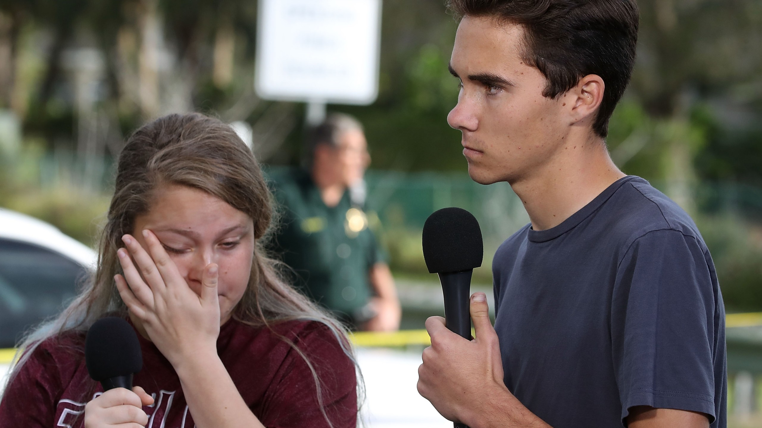 Students Kelsey Friend (L) and David Hogg recount their stories about the mass shooting at the Marjory Stoneman Douglas High School, where 17 people were killed on February 15, 2018 in Parkland, Florida. (Credit: Mark Wilson/Getty Images)