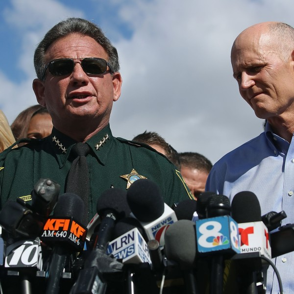 Broward County Sheriff Scott Israel, center, Florida Gov. Rick Scott, right, and Florida Attorney General Pam Bondi, left, speak to the media about the mass shooting at Marjory Stoneman Douglas High School on Feb. 15, 2018 in Parkland, Florida. (Credit: Mark Wilson/Getty Images)