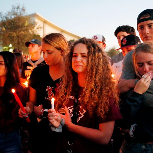 Mourners react during a candlelight vigil for the victims of Marjory Stoneman Douglas High School shooting in Parkland, Florida on Feb. 15, 2018. (Credit: RHONA WISE/AFP/Getty Images)