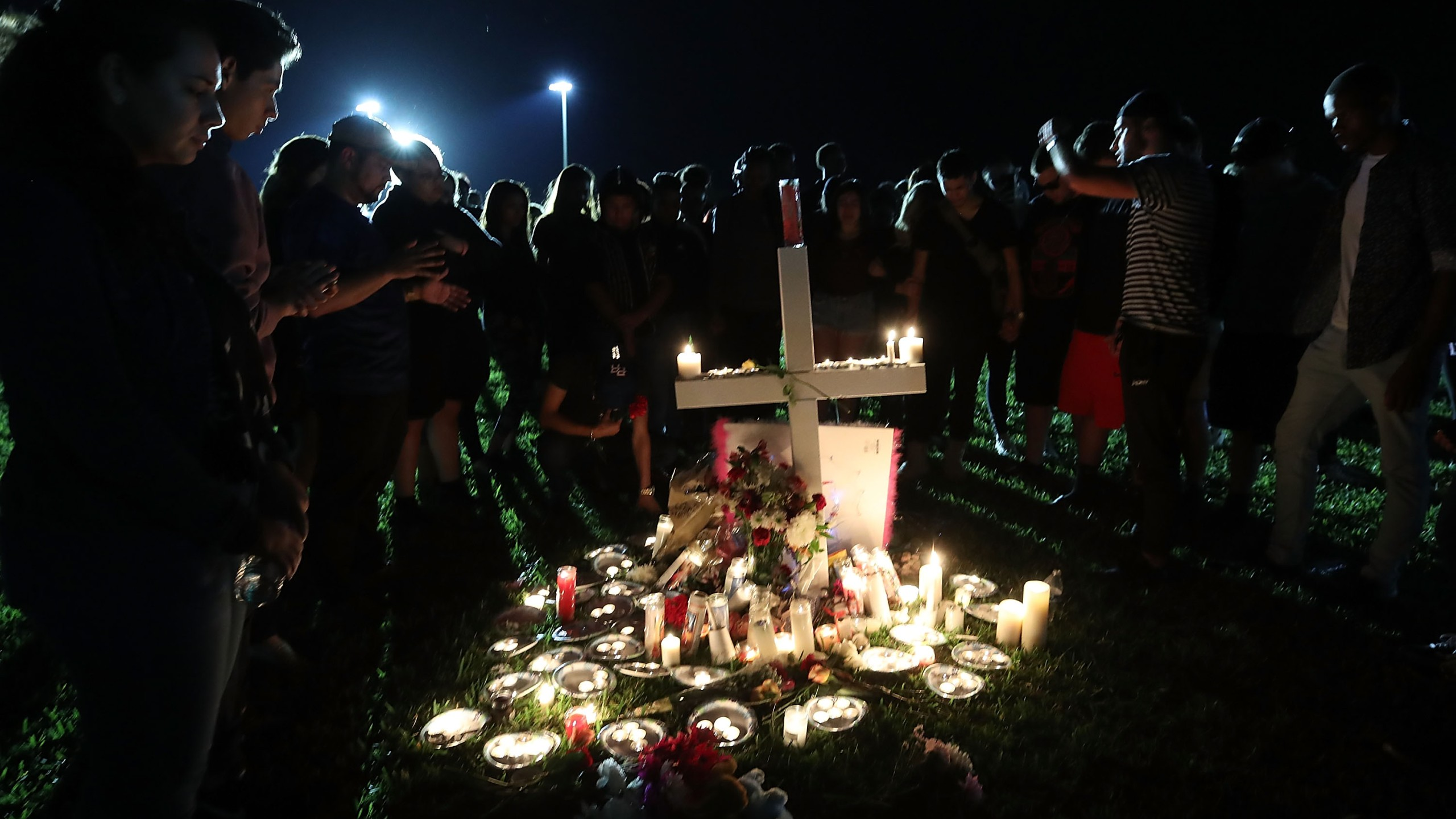 Students, friends and family gather to pray during a candlelight vigil for victims of the mass shooting at Marjory Stoneman Douglas High School, in Parkland, Florida, on Feb. 15, 2018. (Credit: Mark Wilson / Getty Images)