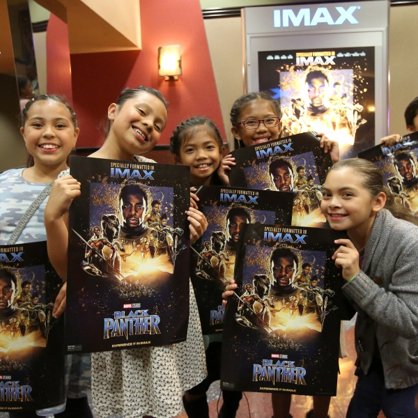 "Boys & Girls Club Long Beach members received the celebrity treatment with concessions and more during an advance IMAX screening of ""Black Panther"" on Feb. 15, 2018 in Long Beach. (Credit: Jesse Grant/Getty Images for IMAX)"