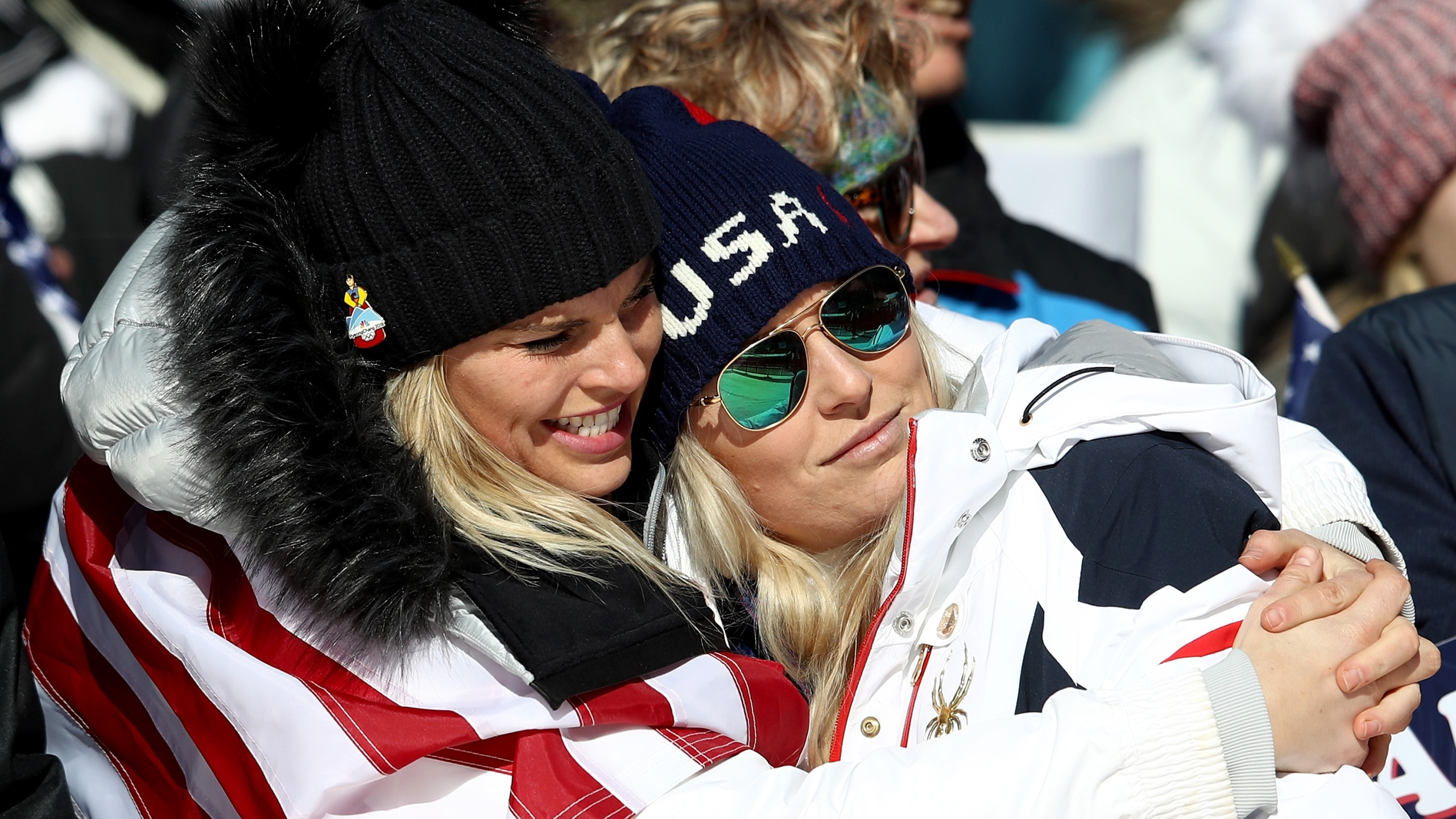 Lindsey Vonn of the United States, at right, is consoled at the finish during the Alpine Skiing Ladies Super-G at the PyeongChang 2018 Winter Olympics on Feb. 17, 2018. (Credit: Clive Mason / Getty Images)