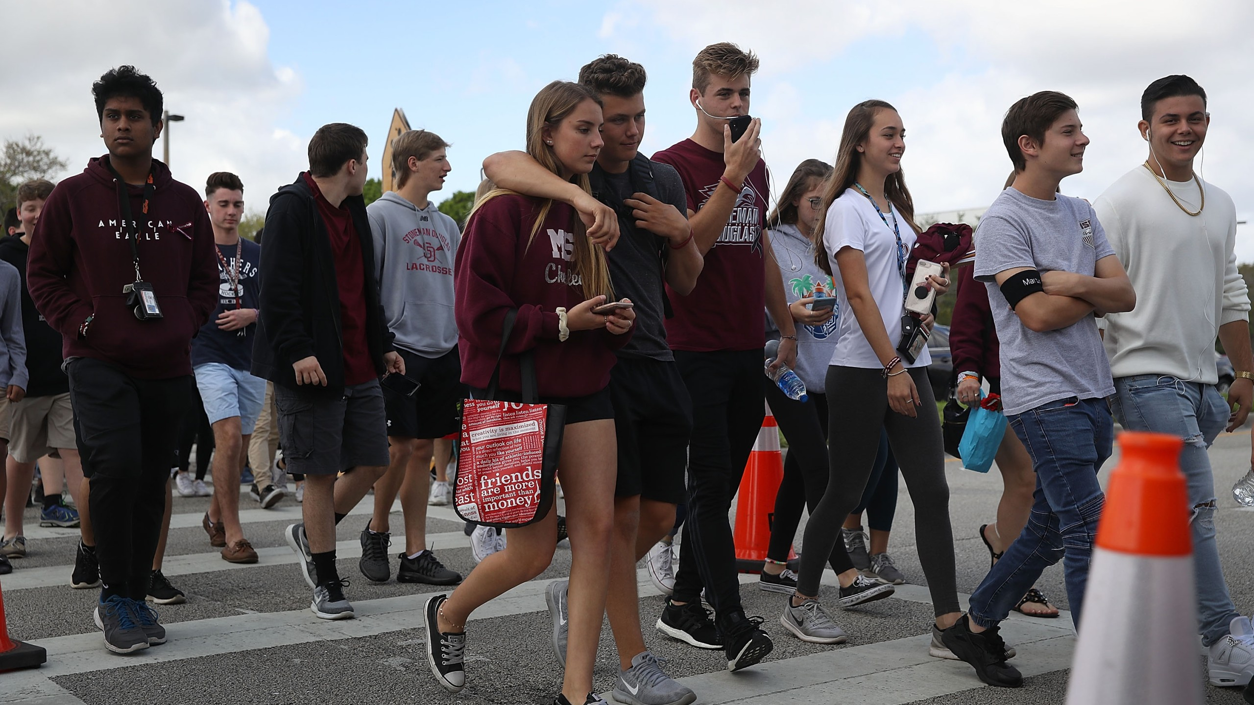 Students leave Marjory Stoneman Douglas High School after attending their classes for the first time since the shooting that killed 17 people at the school, Feb. 28, 2018, in Parkland, Florida. (Credit: Joe Raedle / Getty Images)