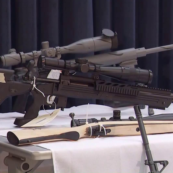 A weapons cache seized at Steven Ponder's Temple City home is shown at a downtown L.A. news conference on Feb. 21, 2018. (Credit: KTLA)