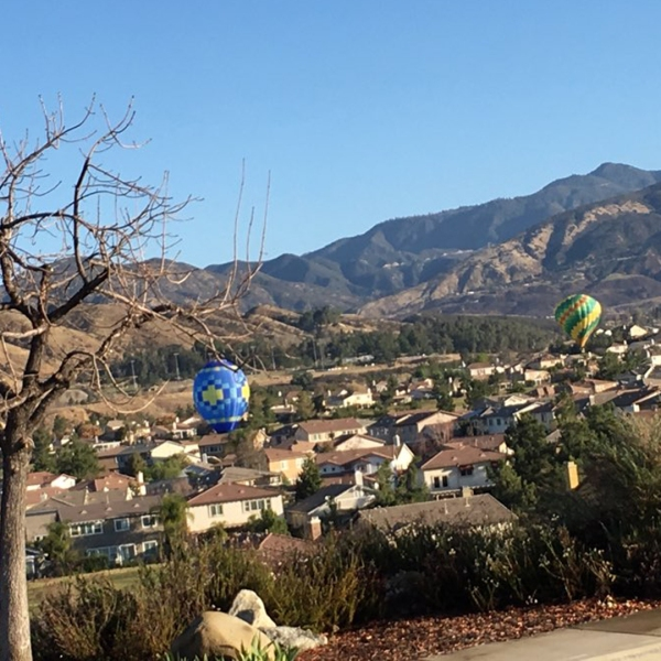 Yucaipa Police Department officials tweeted this photo of hot air balloons that were apparently too close to homes in the area on Feb. 6, 2018.